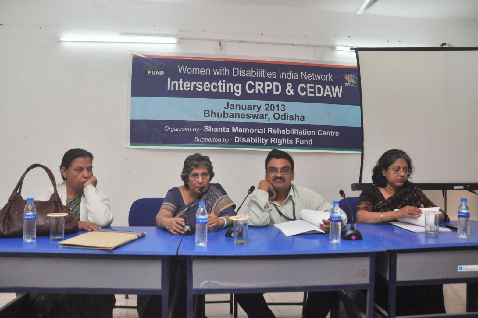 Prof. Asha Hans speaking during an event
