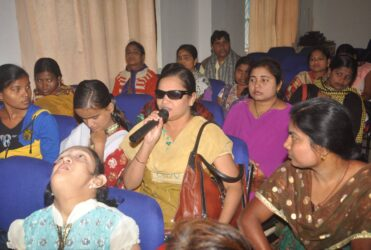 blind woman asking a question during an event