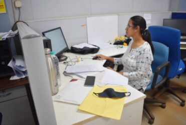 Rosalinee Chaudhury working in the office